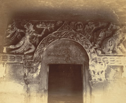 Close view of top of arched doorway with portion of carved frieze above, upper verandah, Rani Gumpha, Udayagiri